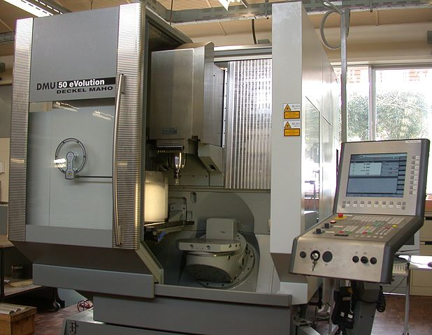 Machining center with rotating table and computer interface