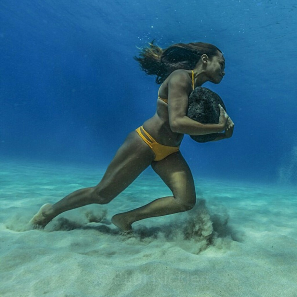 Surfer Training Hawaiian surfer Ha'a Keaulana runs across the ocean floor with a 50 pound boulder, as training to survive the massive surf waves
